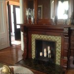 One of four original fireplaces, this massive wood and tile beauty is in the Living Room.