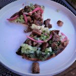 Slow roasted pork flatbread, cumin, red onion, lettuce, salsa verde