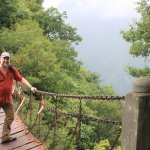 Big guy on a rusty chain bridge. What could possibly go wrong? Memorable!