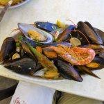 Shellfish platter atop a reservoir of garlic butter
