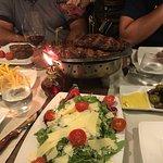 Dinner for 5! Skirt steaks in the pan, ribeye on plates