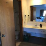 Bathroom of regular western cabin. Sink separate, closet on right.