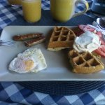 Breakfast 2: Main course: Orange Flaxseed waffles with Maple Whipped cream, eggs, and sausage.