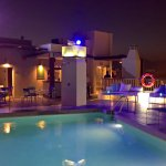 Roof top pool by night at Molina Lario