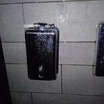 Broken soap dispenser in the shower