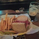 Corned Beef sandwich with mustard and Guinness