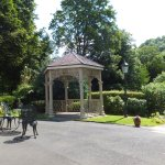 Locally wrought iron gazebo at top of the beautiful garden.
