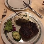 ...a succulent rib-eye steak & baked potato with sour cream...