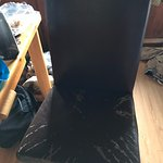 The desk chair which could stand to be replaced.