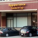 entrance into Eggsperience Pancakes & Cafe from the rear parking lot