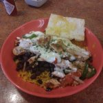 Rice with black beans chicken sauteed onions peppers coverd in cheese