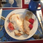 Breakfast crepes, local coffee in a local piece of pottery with Anne's personal photo placements