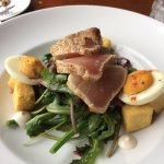 Salad Nicoise with slabs of seared tuna and devilled eggs