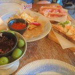 Starters - Nachos, Olives on ice with an amazing dip, smoked salmon, and prosciutto board.