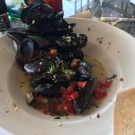 mussels in white wine sauce with pico... sour dough bread for dipping