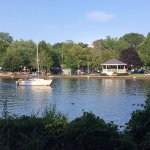 A boat on the water at the bottom of Mount Baldhead Park.