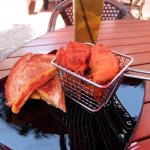 red tone from shade covered umbrella...ahhh perfect shade too! Grilled cheese, sweet potatoe fri