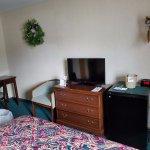 Mini-fridge, dresser, chair, tv, alarm clock, ice bucket, hangers