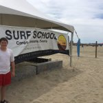 Student and the surf school tent