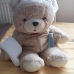 came back to this teddy! think he needs a shower lol! cute touch!!
