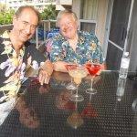 Friends enjoying drinks on lanai at Maui Banyan