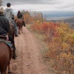 Check out that view! Just a glimpse of a trail ride with us.