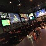 13 Giant Screens & 52 Flat Screens