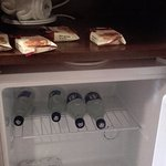 Mini-fridge stocked with complimentary bottled water etc. Impressed!