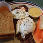 Corned beef hash with hollandaise sauce, poached eggs, toast with fresh papaya jam! Great servic