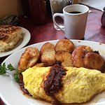 Omelette creole with American potatoes and a homemade biscuit