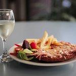 Delicious Chicken Schnitzel accompanied by a fine glass of Tasmanian White Wine