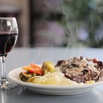 Steak with seasonal vegetables enjoyed with a glass of Tasmania's finest red wine