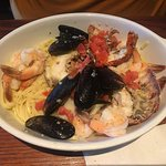 Bar Harbor Lobster Bake: lobster tails, shrimp, scallops, mussels, and tomatoes over linguini wi