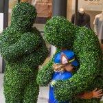 Fun Hedge Men hugging a child guest at LDO