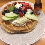 my waffle with assorted fruit and home made syrup in bottle