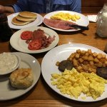 Country ham, corned beef hash, eggs, pancakes, biscuits, gravy, fried potatoes and sausage.
