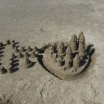 Sand castles artwork on the beach