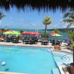 View of pool, outdoor seating, seven mile bridge