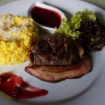 Tender loin of pork with cranberry sauce and rosotto