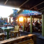 Sun setting on the outdoor dining area of Fishy Fishy Cafe, Southport, NC