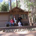 Our family of five posing outside of our cabin meant for three!