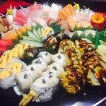 Love boat B TOGO order!! 14pcs sushi, 14 pcs sashimi, 1 spicy tuna, 1 vegas, 1 north pole roll,