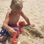 My grandson just playing in the sand!