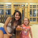 Granddaughter & great granddaughter posing in the lounge.