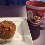 A morning muffin break with a whimsical cup of coffee.