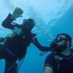 Lucas from Cayman Turtle Divers to left helping guide me in diving when I was drifting