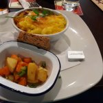cottage pie with a side of veggies and brown bread