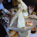On the top plate: melt in your mouth shortbread, cake wedges, fruit tart, & more!