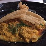 Our favourite! A blue crab egg curry with spicy chilli jam, picked onions and dill
