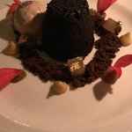 lava cake with poached pear and gold leaf
